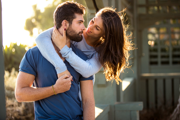 Scorpio man and his girlfriend look into each others eyes in love infatuated