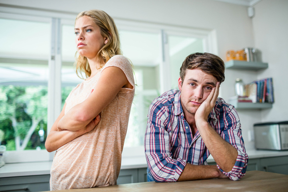 Annoyed couple ignoring each other in the kitchen - Scorpio Man's Turn Ons and Turn Offs