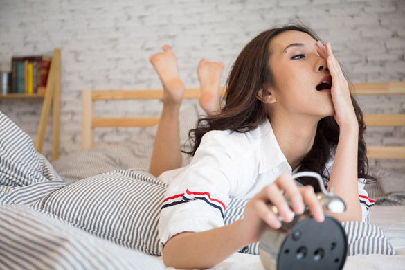 Beautiful Asian lazy woman yawn in the morning while looking the vintage alarm clock - Things That A Scorpio Man Likes And Dislikes In A Woman