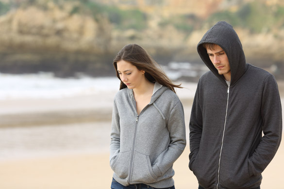 Couple of angry and sad teenagers together walking on the beach - How Can You Tell a Scorpio Man Is Done With You