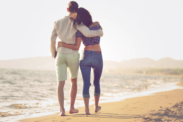 Couple walking on beach - What is it Like to Date a Scorpio Man