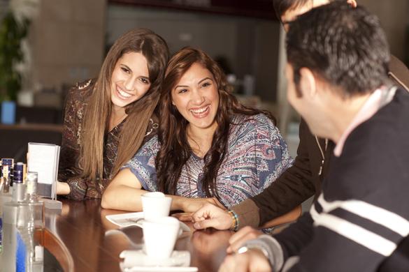 Two beautiful young women with great teeth enjoying their lunch break - How to Meet a Scorpio Man