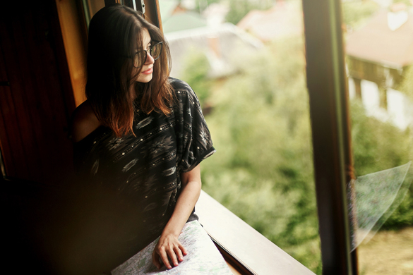 woman holding map sitting at window with view at amazing mountains in wooden house - What Should You Do if a Scorpio Man Asks you to Quit Calling Him